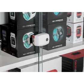 Invue universal lock to secure merchandise in cabinets
